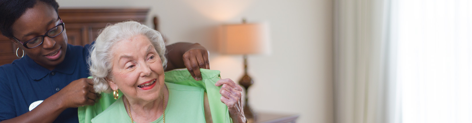 Caregiver Helps with Clothes