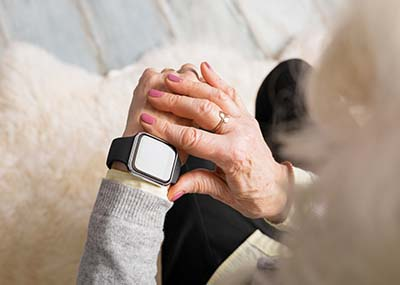 senior wearing a smart watch