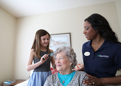 Brookdale resident with granddaughter and caregiver