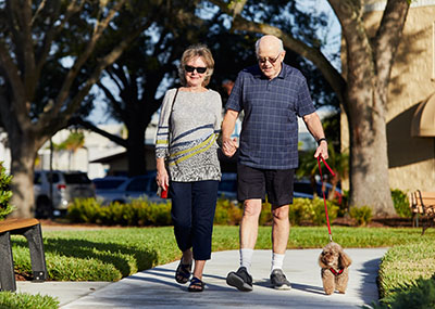 Brookdale couple walking their dog