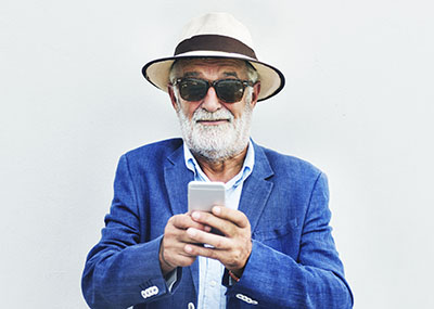 Hip older male with an iPhone
