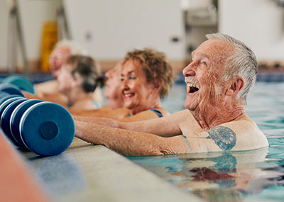 older adults exercising in pool