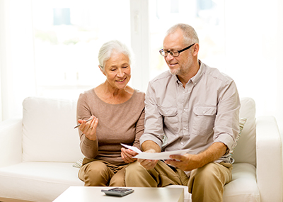 Older couple looking at options to paying for senior living