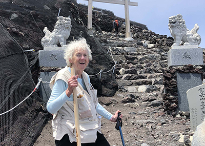 Marilyn poses for a photo as she climbs to the summit of Mount Fuji in Japan.
