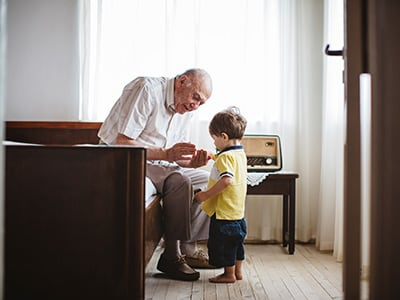 elderly man with his greatgrandson
