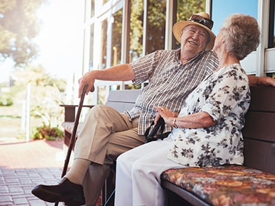 elderly couple sitting on the patio