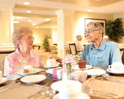 older couple eating dessert