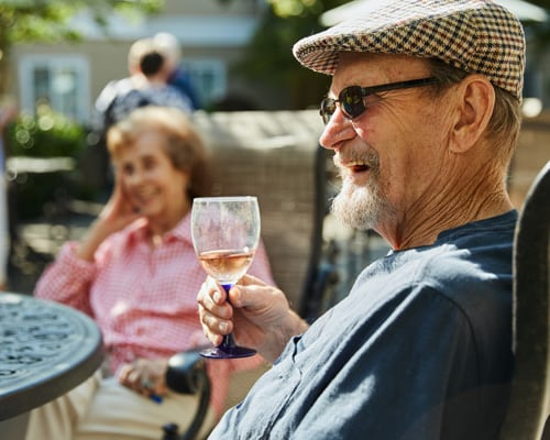 man smiling with wine glass