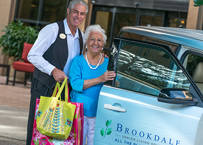 Brookdale employee helping a woman