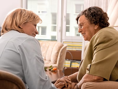 woman talking with senior woman