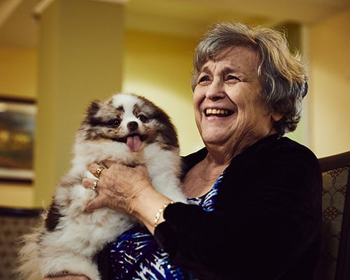 woman smiling with a dog