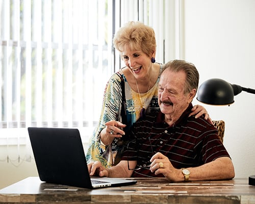 couple comparing communities on the computer