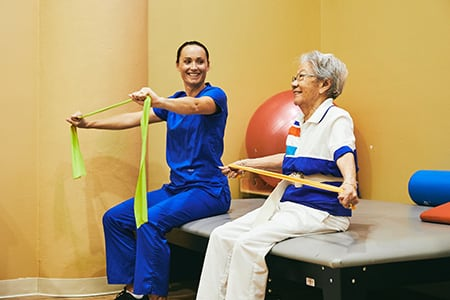 associate and woman doing exercises